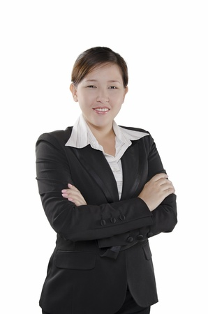 Portrait of business person standing with arms crossed photo