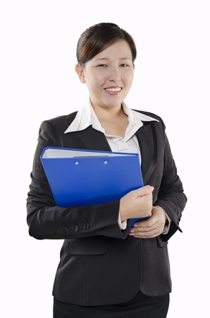 Businesswoman standing with document in hands photo