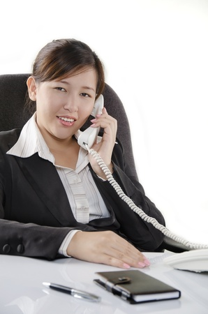 Young woman making a phone call in office photo