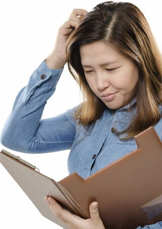 uncertainty: Businesswoman scratching head while thinking