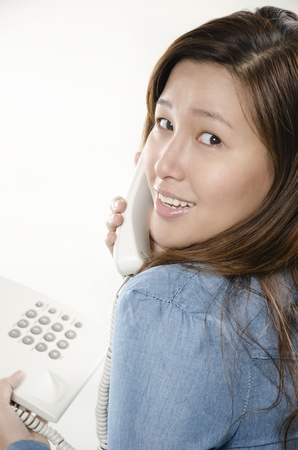 Smiling business woman talking on the phone, photo
