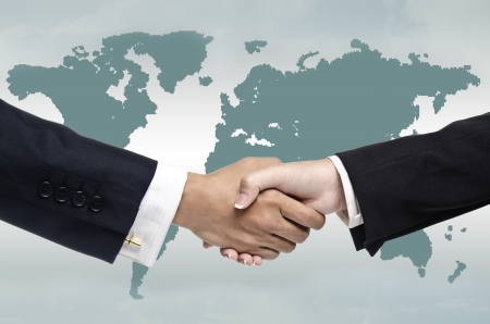 deal in: business deal with global map in the background
