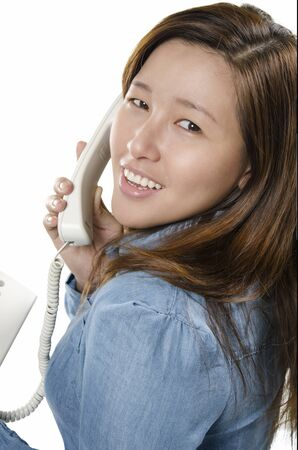 Pretty young woman smiling on the phone photo