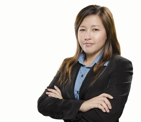 Pretty businesswoman standing against white background