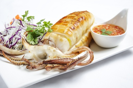 Grilled squid with chili sauce Stock Photo
