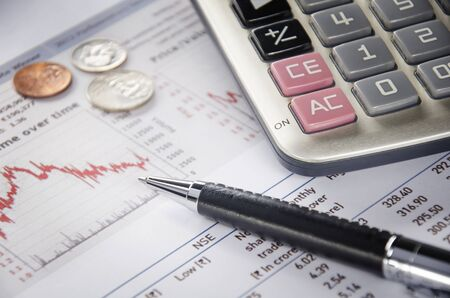 US coins and calculator on financial figure Standard-Bild