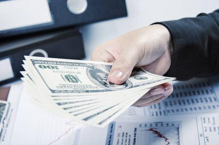 Businesswoman holding money in her hand photo