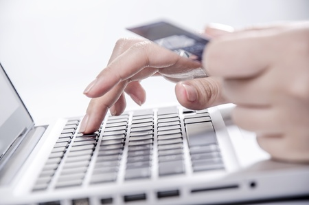 Shopping online with credit card on laptop photo