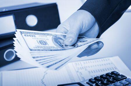 Closeup of businesswoman giving money photo