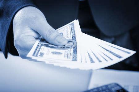 Closeup of giving money of US dollars photo