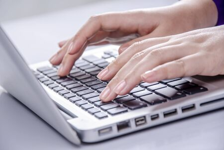 Beautiful woman hand typing on laptop Stock Photo - 18872554