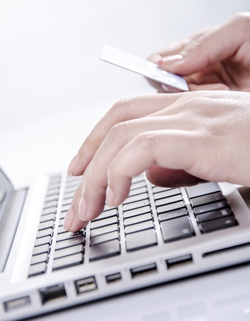Concept of e-commerce with closeup of holding credit card