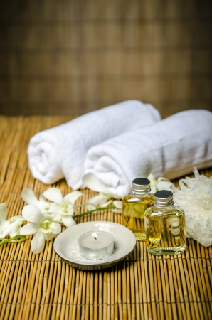 massage oil: Massage concept, massage oil and white towels Stock Photo