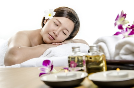 Beautiful lady relaxing in concept of spa treatment photo