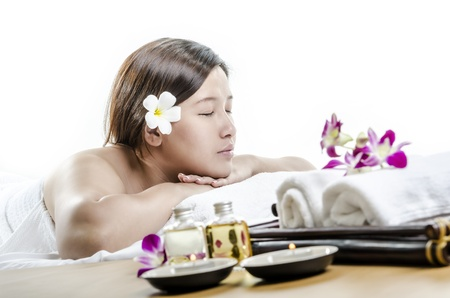 Relaxing young lady in spa and massage concept photo