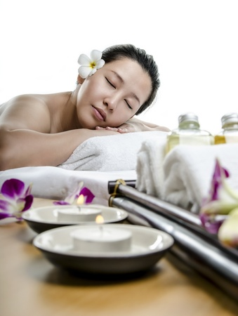 Young beautiful lady laying down at spa treatment photo