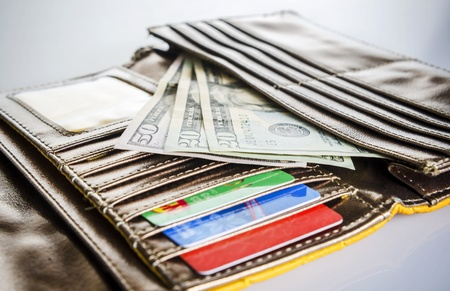 exchanging: Closeup of money and credit cards in wallet