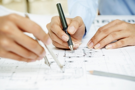 Macro of hands working on architecture drawing plan Stock Photo - 21424910
