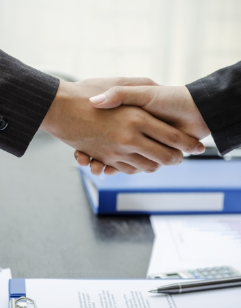 two people only: Business people shaking hands at work Stock Photo