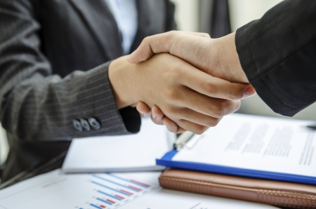 Business persons shaking hand as a deal