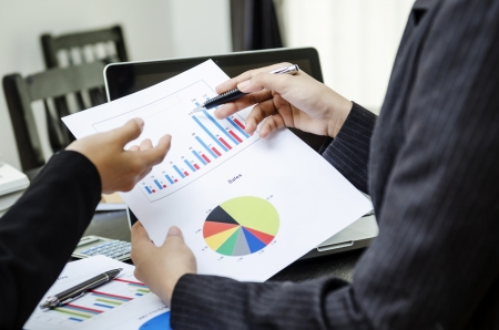 Two business people discussing on graph Stock Photo