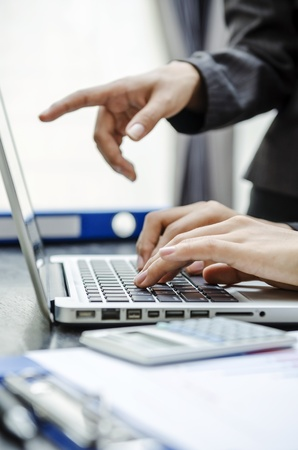 Business person pointing to laptop screen Standard-Bild