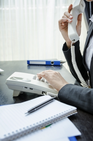 Business person using a telephone Stock Photo - 21958311