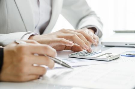 Reviewing financial figure Standard-Bild