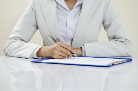 Business writing on documents Stock Photo