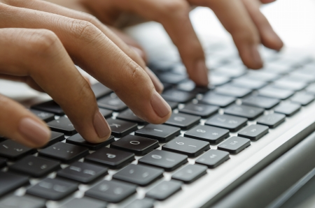 Female hands typing on laptop photo
