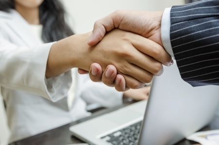 Business people greeting with handshaking photo