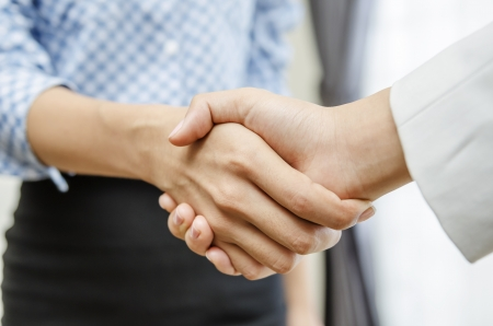 Business handshaking in the office