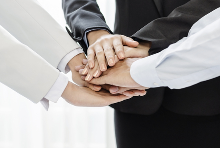 joining hands: Business people joining their hands in agreement