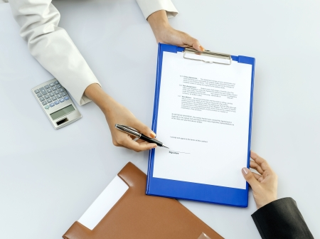 Business person give a contract to sign