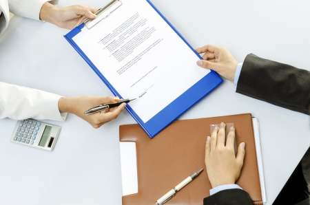 Business person about to sign contract Stock Photo