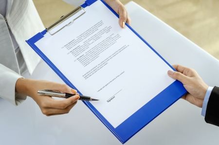 Businesswoman showing contract to partner