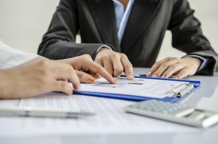 Business people work as team in office Banco de Imagens - 24498790