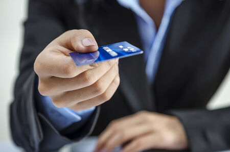 Bank office worker providing credit card photo