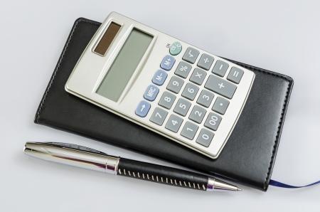 note book: Calcolatrice, taccuino e penna