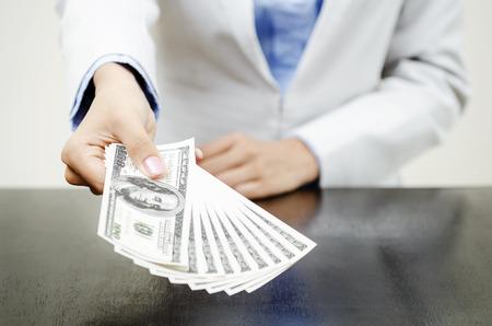 Money in hands of businesswoman Standard-Bild