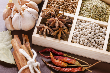 herbs boxes: white wooden frame collection of spices Stock Photo