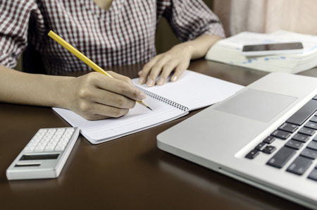 Image of woman taking note Stock Photo