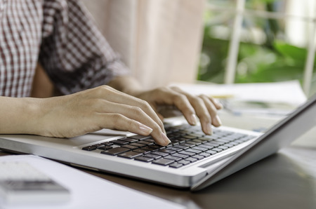 research paper: Image of woman using a laptop Stock Photo