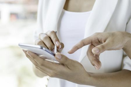 stylus pen: Closeup of women using tablet with stylus pen