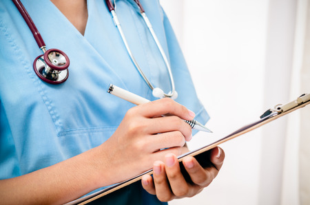 surgeon taking records about patient after surgery