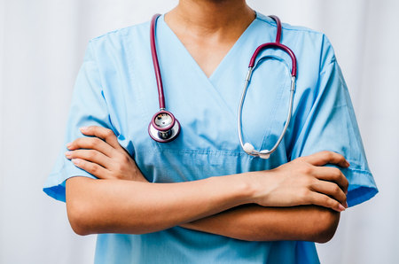 surgeon standing with arms fold across chest