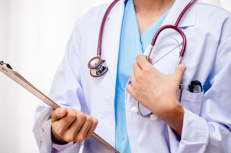 doctor in her uniform holding her document and stethoscope