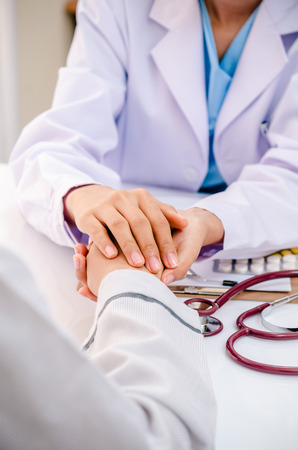 portrait of doctor consulting and cheering patient