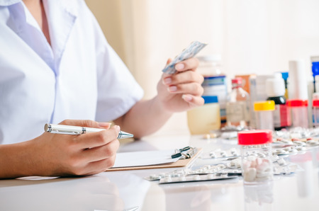 medicine: close up of medicines, drugs and pharmacist
