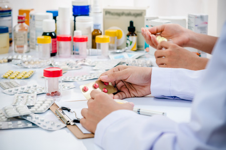 two pharmacists preparing medicine container in a pharmacy